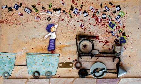 illustration lutin sur un train qui essaye d'attraper des lettres dans son filet