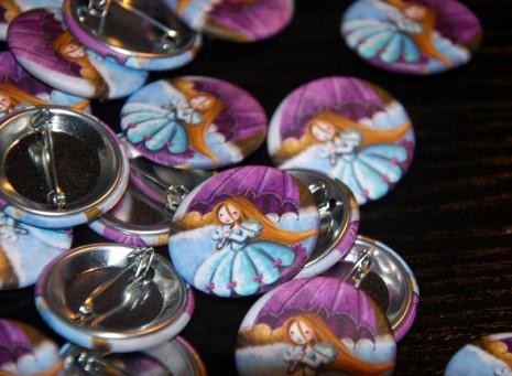 petite princesse au parapluie imprimée sur un badge