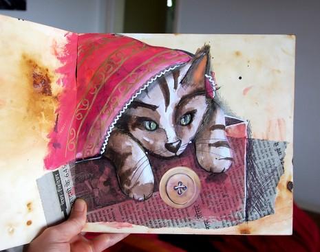 carnet de croquis ouvert sur la page du chat