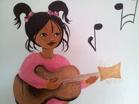 une indienne qui joue de la guitare