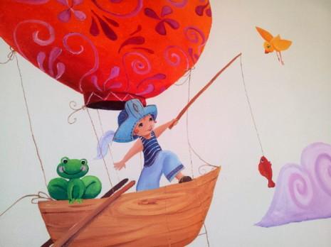 petit pirate qui pèche un poisson dans un beateau-montgolfière